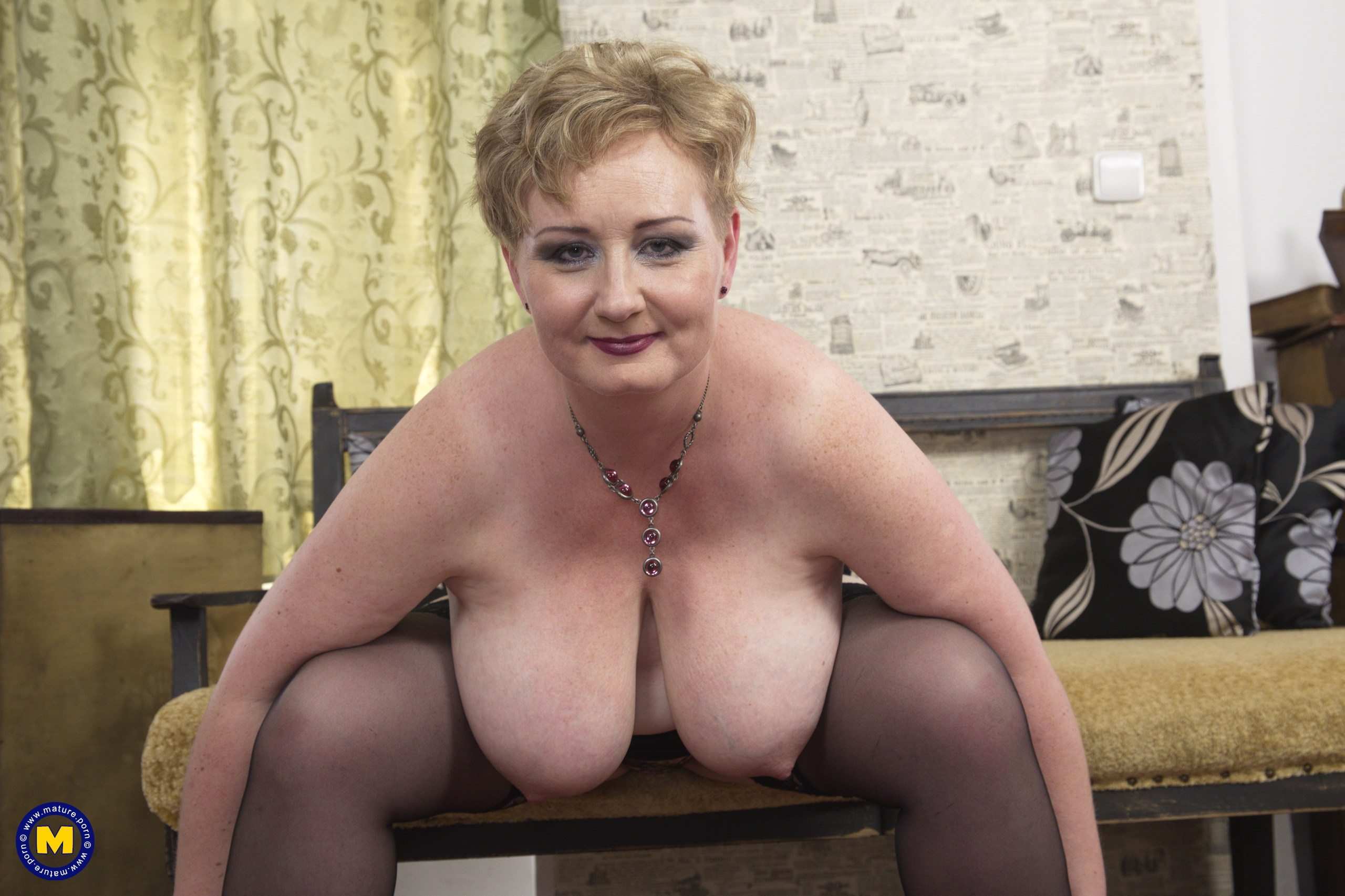 Round mature doll showing off her gigantic knockers